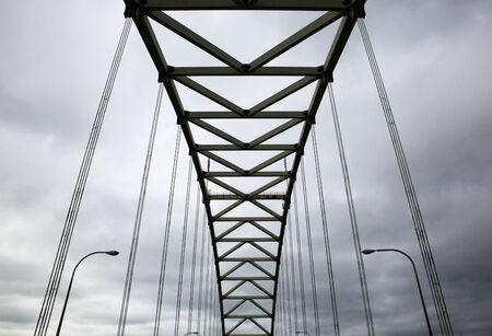 Suspension Bridge on a gray cloudy day Banco de Imagens - 29655346