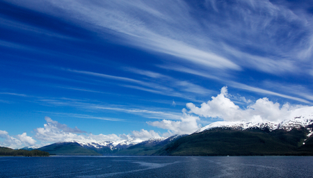 Alaskan Sky and snow topped mountain in Turnagain Arm Banco de Imagens - 29987809