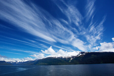 Alaskan Sky and snow topped mountain in Turnagain Arm Banco de Imagens