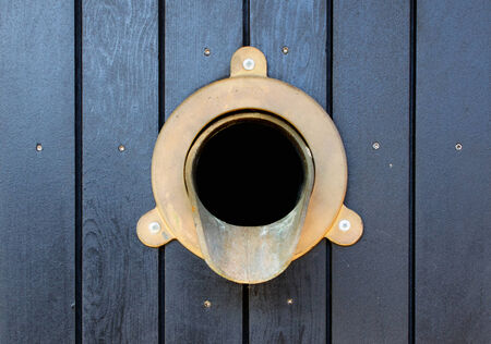Wall Brass Gutter downspout that is part of a water drainage system