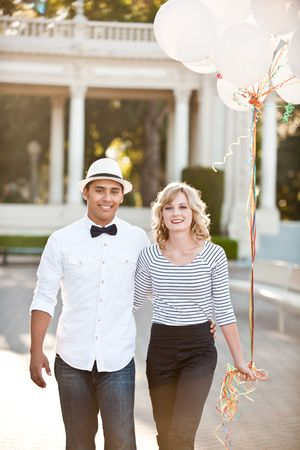 A cute couple with balloons Stock Photo - 8138052