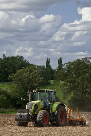 Tractor pulling a plough followed by hungry seagulls Editorial