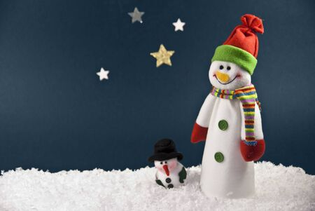 Two Snowmen against a Blue Night Sky with room for your writing