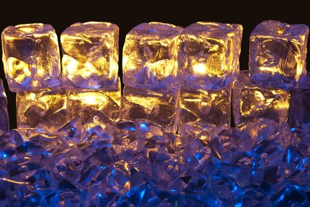 Blue and Gold Illuminated Ice Cubes on a Isolated Black Background Stock Photo - 10656213