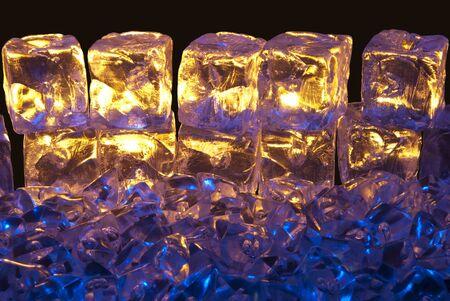 Blue and Gold Illuminated Ice Cubes on a Isolated Black Background Stock Photo