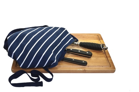 Carving knife and fork laying on Carving Board Isolated on White