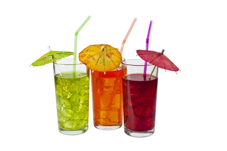 Three Glasses of refreshing iced drinks, with straws and Parasols. Isolated on white. Stock Photo