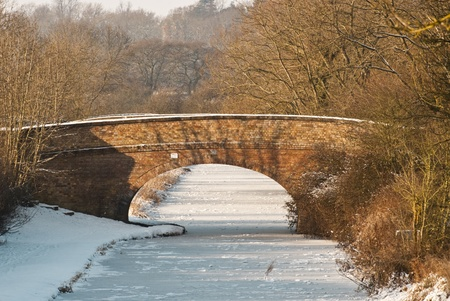 Bridge across a frozen canal in mid-winter Stock Photo - 10913089