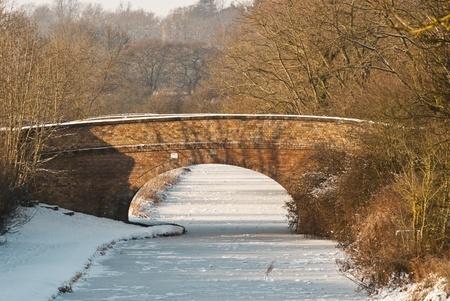 Bridge across a frozen canal in mid-winter