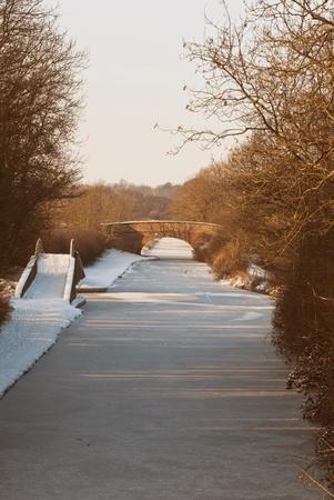 Bridges across a frozen canal in mid-winter