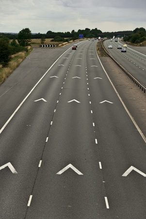 View of a motorway showing the safety vehicle spacing chevron markers photo