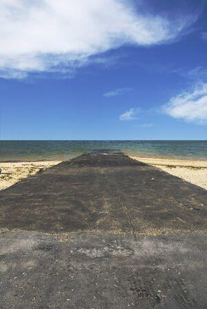 Road leading into the sea