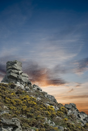 Small hill with outcrop of rock at the summit Stock Photo