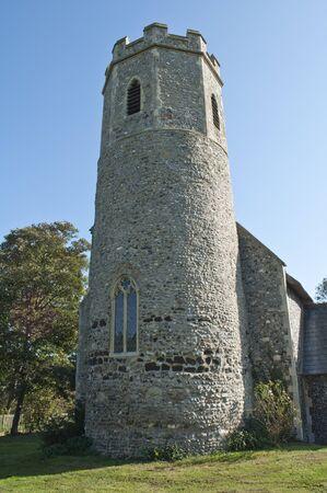 Ancient English Circular and Octaganol Flint Church Tower Stock Photo