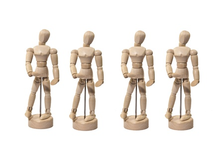 Four Identical Wooden Artist Dummies in a Line-up Isolated on White