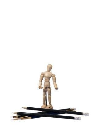 Miniature Artist Wooden Model with Pencils and Brushes Isolated on White Stock Photo