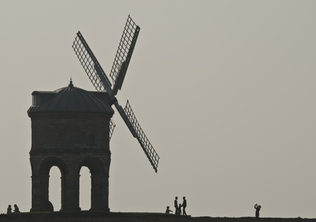 On a misty Spring day people visit an old Windmill