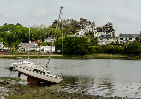 Small yacht left high and dry by the receding tide