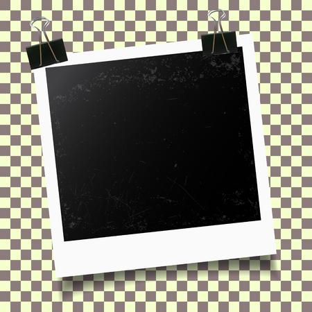 binder clip: Blank photo frames. Retro photo frame with binder clip on checkered background. Vector illustration.