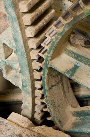 meshed: Close up of some large wooden gear wheels wheels meshed together
