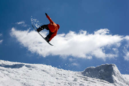 snowboarder jumping: Snowboarder jump from snow- ramp. Stock Photo