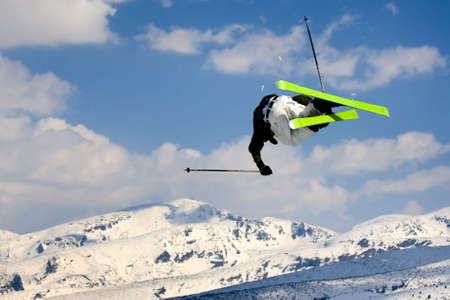 Extreme skier jumping  over the  snow -mountain.
