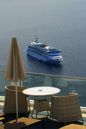 Santorini view with a cruisership in background. photo
