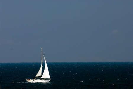 Sailing boat at an open sea, Greece