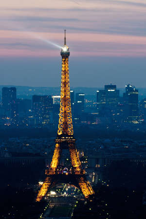 lighten: Paris, France, 30 June, 2010:  Eiffel Tower at night . Eiffel tower is the most visited monument of France and the most recognizable landmark of the world..