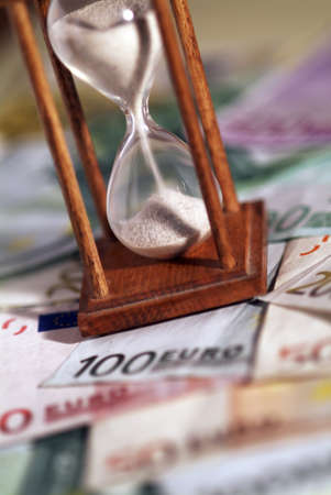 bussiness time: Time is money  A sand-glass and the European currency