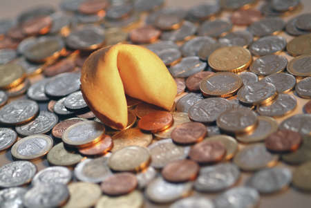 Fortune cookie with many coins  photo