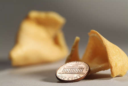 One cent coin with a fortune cookie Stock Photo - 16843046