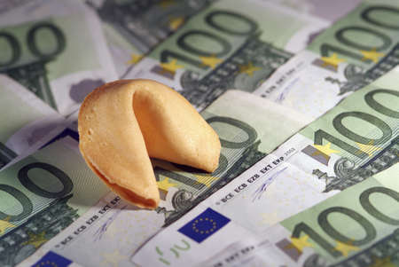 Traditional Fortune Cookies on a Background of Euros  Banco de Imagens