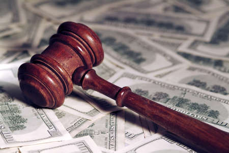 mallet: Court gavel on money background.Shallow focus.