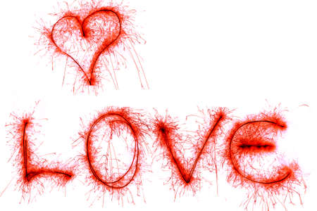 heart heat: Word Love and heart of red sparklers isolated on  white  background.