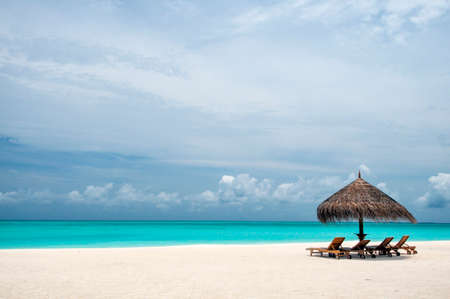 loungers: Maldives tropical beach and Sun loungers Stock Photo