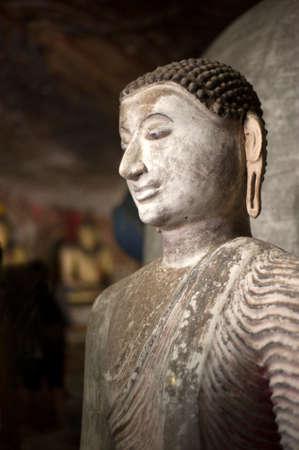 buddha sri lanka: Ancient Buddha images in Dambulla Rock Temple caves, Sri Lanka