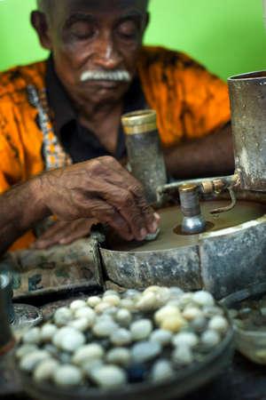 mined: Meetiyagoda, Sri Lanka - January 02 2015: A man grinds moonstone on a in a moonstone mine, Sri Lanka on January 02 2015. Moonstone is widely mined in Sri Lanka