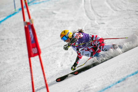 competes: BANSKO, BULGARIA - MARCH  2, 2015:Cornelia Hueter (AUT) competes in the Audi FIS Alpine Ski World Cup Ladies Super G on MARCH  2 ,2015 in Bansko, Bulgaria Editorial
