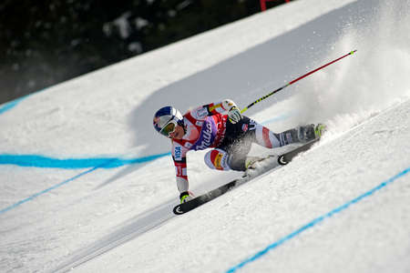 competes: BANSKO, BULGARIA - MARCH  2, 2015: Lindsey Vonn (USA) competes in the Audi FIS Alpine Ski World Cup Ladies Super G on MARCH  2 ,2015 in Bansko, Bulgaria Editorial