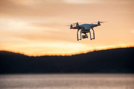 phantom: SOFIA, BULGARIA - JUNE 22, 2015: Image of the phantom 3 professional quadcopter flies against a beautiful sunset in the background on the June 22, 2015 ,Sofia, Bulgaria. Editorial