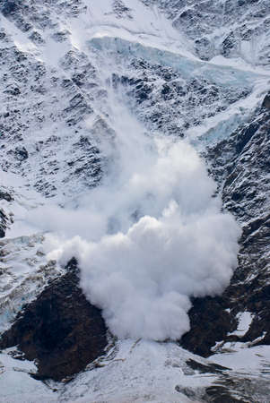 avalanche: Snow avalanche on mountain slope Stock Photo
