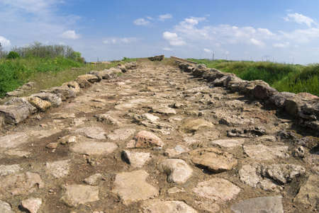 The road paved with rough yellow stones