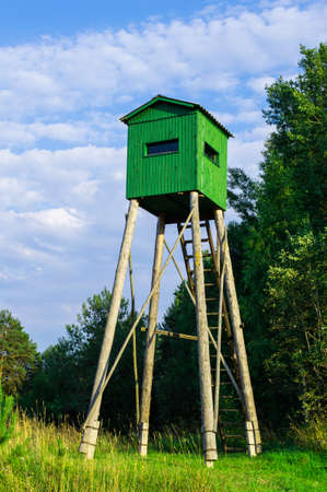 sunup: Lookout tower for hunting at dawn Stock Photo