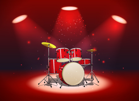Bright red drum set in the light of spotlights on scene