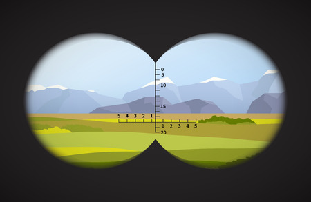 View from binoculars on landscape with fields and mountains