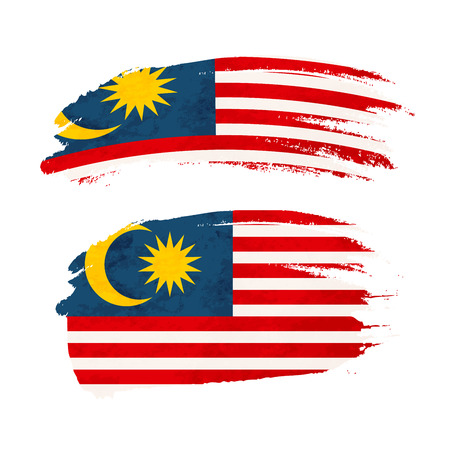 Grunge brush stroke with Malaysia national flag isolated on white