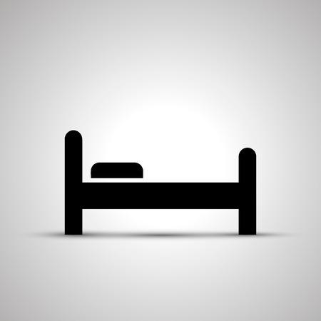 Bed silhouette, side view simple black icon with shadow.