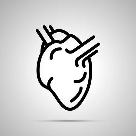 Simple black human heart icon with with shadow on gray