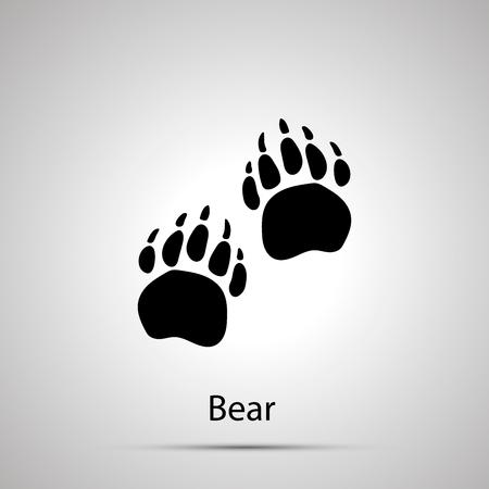 Pattes d'ours, empreintes de pas, silhouette noire simple sur fond gris Vecteurs